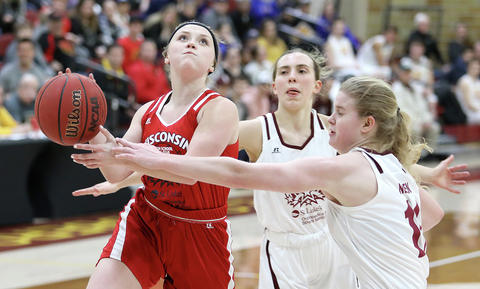 Northwestern's Mackenzie Correll gets fouled by Mt. Iron-Buhl's Alexandra Negen during the 11th Annual DAYBA Border Battle Tuesday night at Romano Gym on the UMD campus. (Jed Carlson / jcarlson@superiortelegram.com)