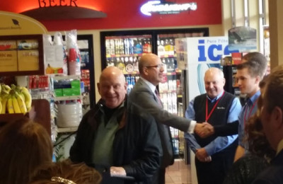 Mayor Hagen speaking at Ribbon Cutting ceremony today at Hammond Avenue Kwik Trip. Chamber President David Minor is shown shaking hands, while Don Zeitlow smiles at the camera | Explore Superior©