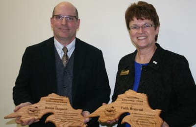 Robin Shepard (L) and Faith Hensrud (R) were honored December 3, 2015 at UWS