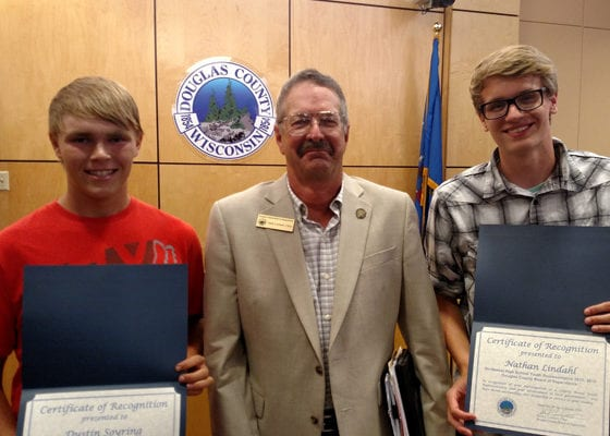 COUNTY BOARD YOUTH DELEGATES RECOGNITION: County Board Chairman Mark Liebaert (center) gave certificates of appreciation to youth delegates Dustin Soyring (left) and Nathan Lindahl (right).