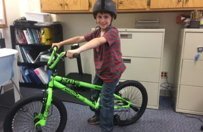Gavin Lambert won a bike at the Bryant Smart Start Day | School District of Superior