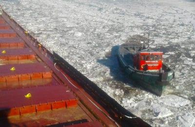 "Tug Boat ""North Carolina"" breaking ice as the Kaye E. Barker began her journey to the Soo Locks"