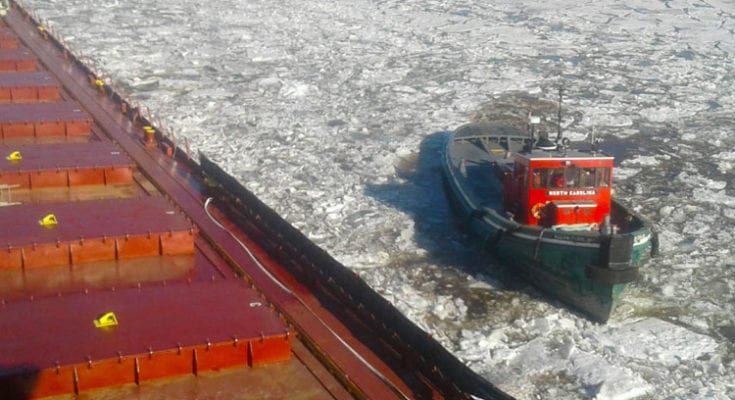 "Tug Boat ""North Carolina"" breaking ice as the Kaye E. Barker began her journey to the Soo Locks"